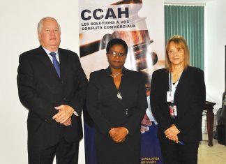 LE PRÉSIDENT du conseil de la CCAH, Wilhelm Lemke, la présidente de la CCIH, Carline Joseph et la directrice du CFI, Norma Powell.