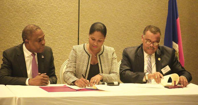 Jean Henry Céant, Premier Ministre, Tessa Jacques, DG CFI, Ronell Gilles, Ministre MCI. CFI